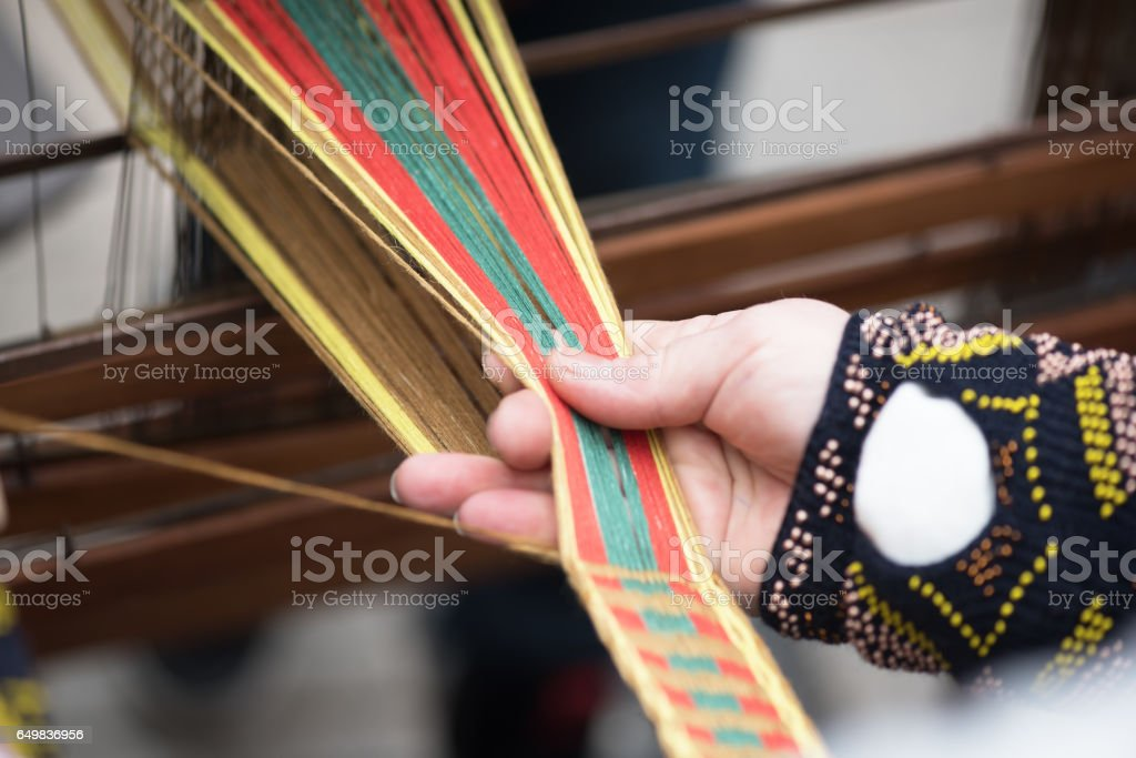 Hands Of Woman In Action Weaving Traditional Lithuanian Ethnic Band