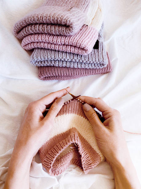 hands of woman knitting stock photo