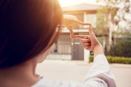 Hands Of Woman Making Frame Gesture With Home Background Planning For The Future Resident Concept Stock Photo - Download Image Now