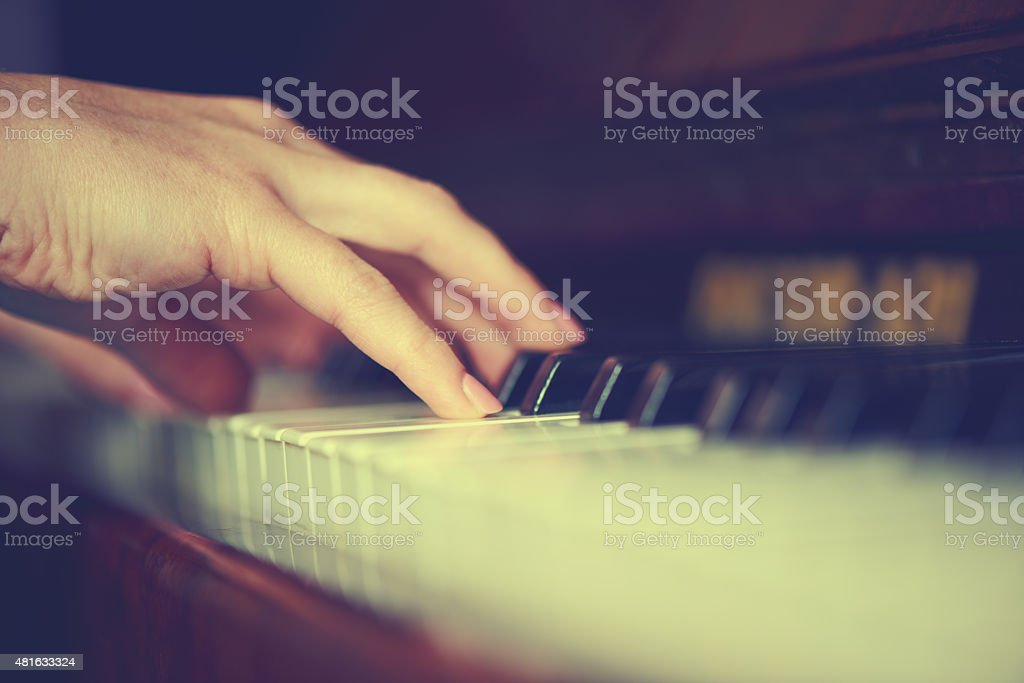 hands of woman pianist on piano keyboard stock photo