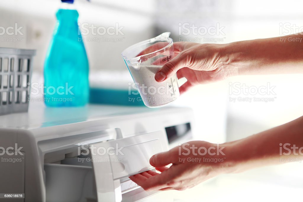 hands of woman that fills detergent stock photo