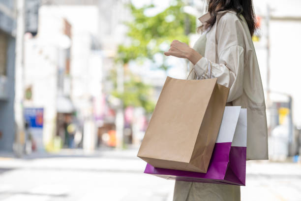 Hands of woman with many shopping bags at shopping stock photo