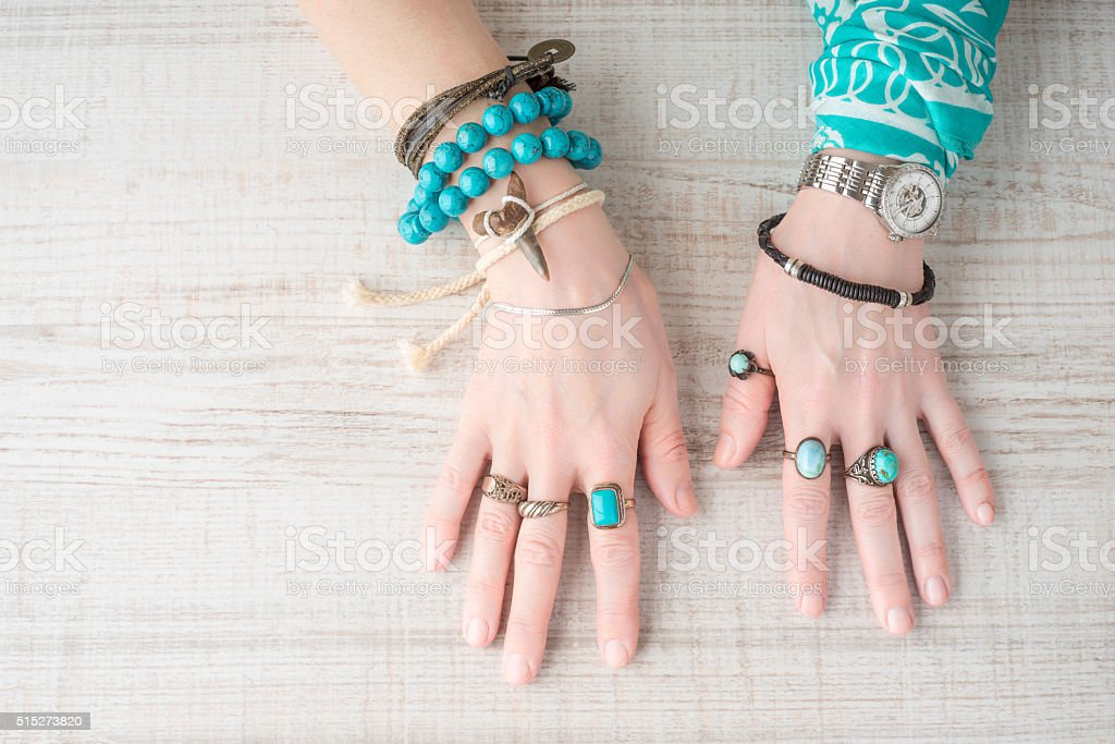 Hands of women in the jewelry of turquoise stock photo