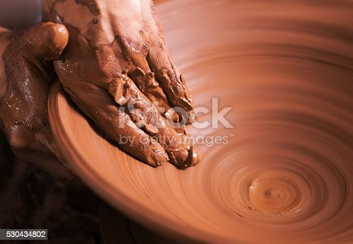 istock Hands of young potter, was produced on range of pot. 530434802