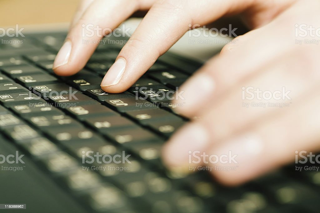 Hands on a keyboard royalty-free stock photo