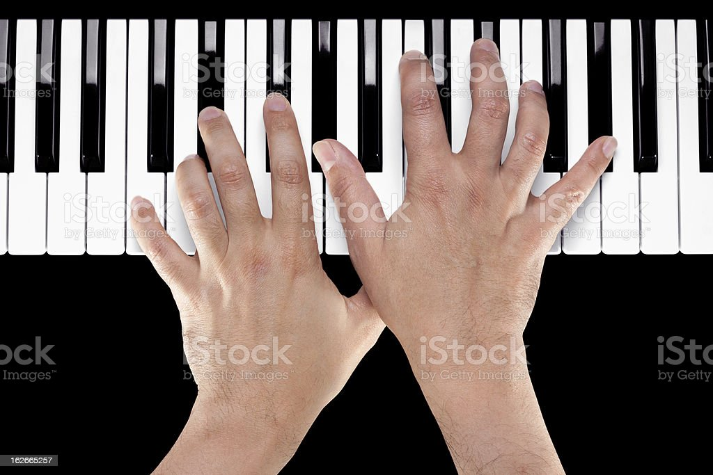 Hands on a Piano Keyboard stock photo