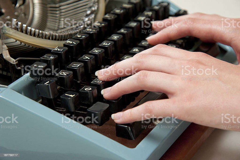 hands on a typewriter royalty-free stock photo