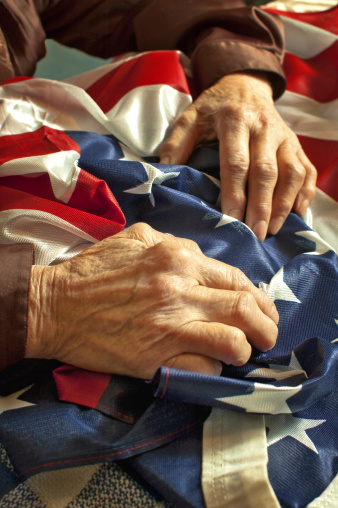 istock Hands on American flag 176556018