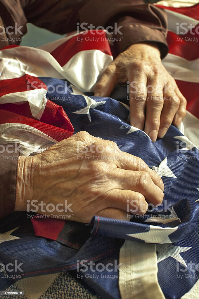 Hands on American flag stock photo