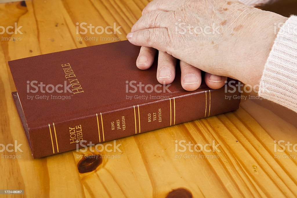 Hands on bible royalty-free stock photo