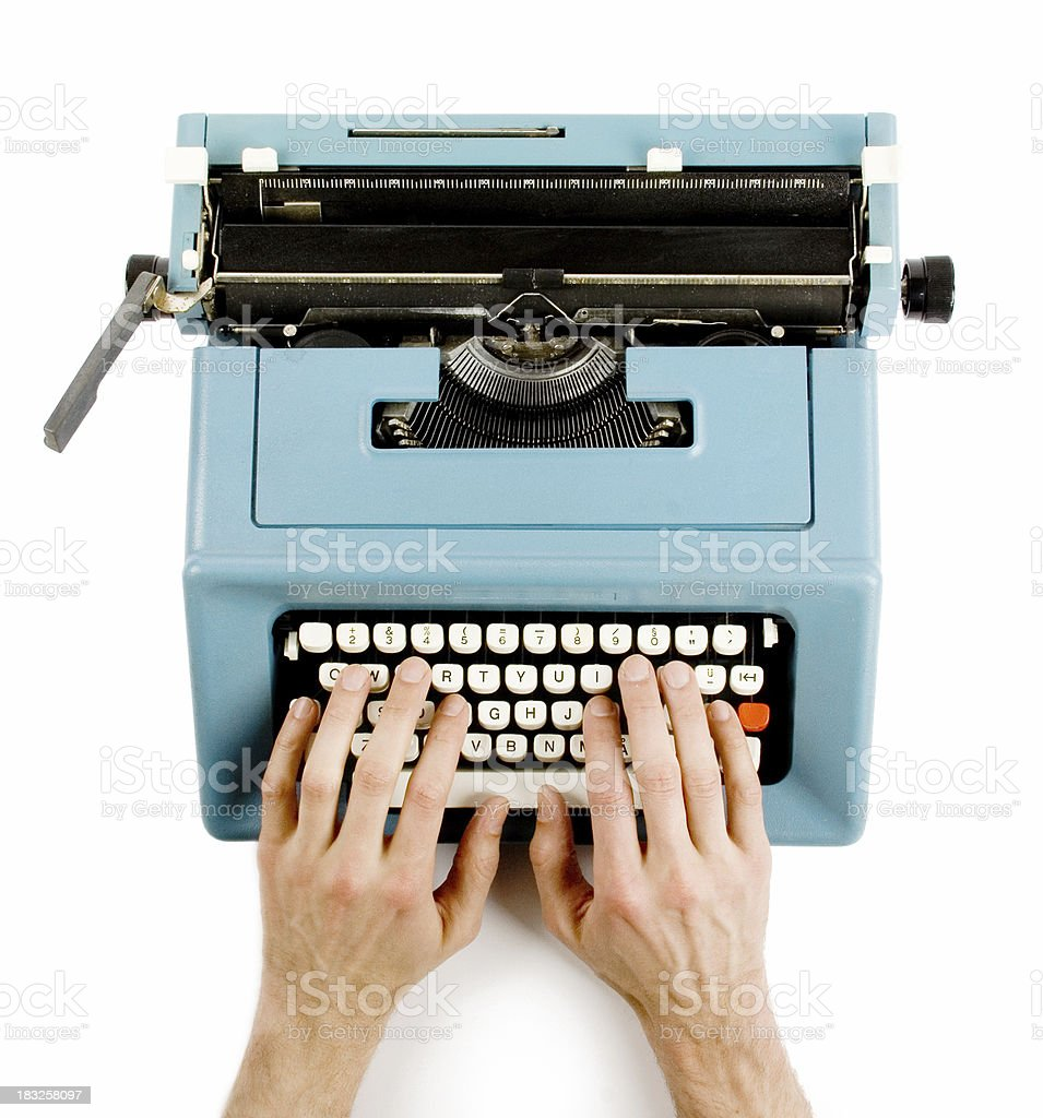 Hands on classic typewriter stock photo