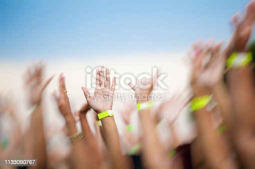 Everybody moving the hands for a concert