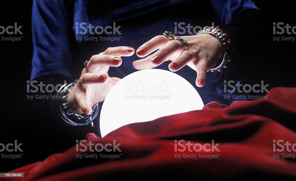 hands on glowing crystal ball royalty-free stock photo