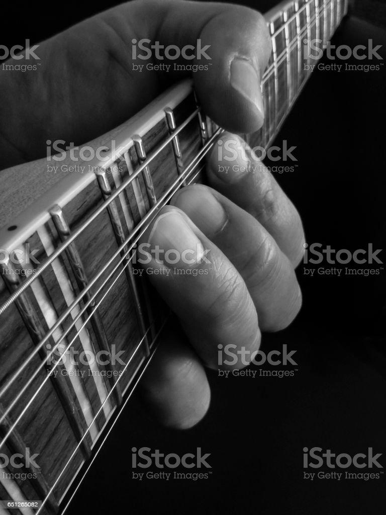 Hands on Guitar Fretboard stock photo