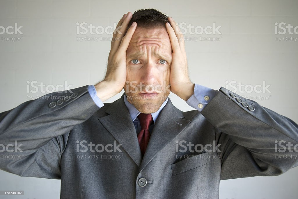 Hands on Head Businessman Looks Bummed royalty-free stock photo