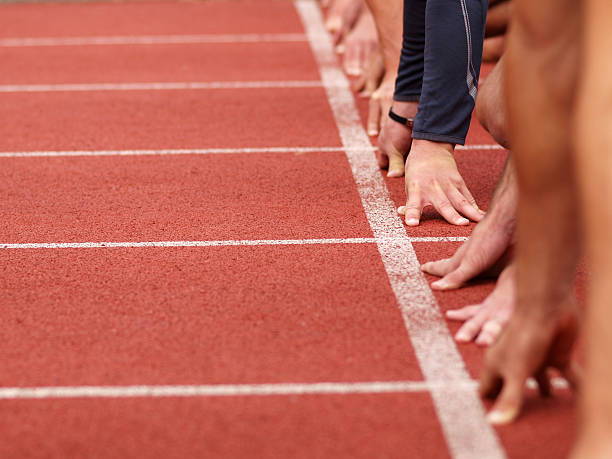 Hands on starting line  track starting block stock pictures, royalty-free photos & images