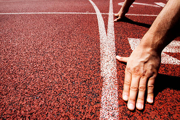 Hands on starting line Hands on starting line sprint stock pictures, royalty-free photos & images