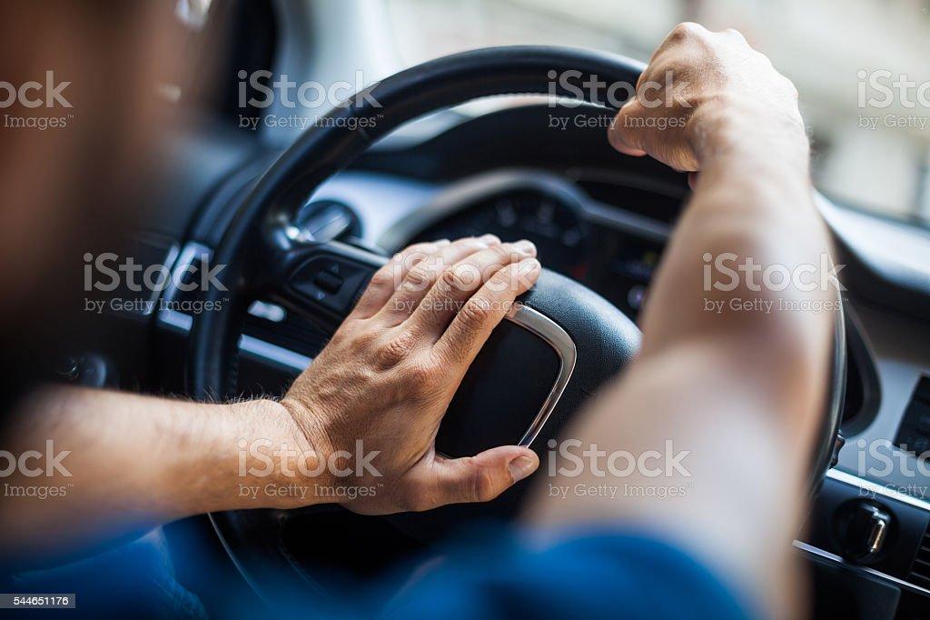 Hands on steering wheel, honking stock photo