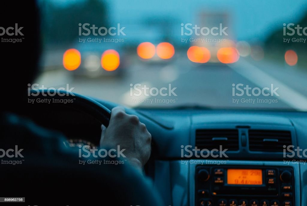 Hands On Steering Wheel Man Driving A Car By Night Stock Photo Download Image Now Istock