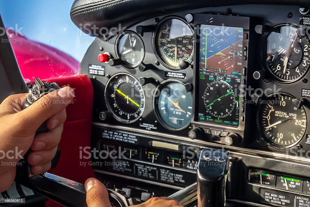 Hands on Stick in Aircraft Cabin During Cruise Flight stock photo