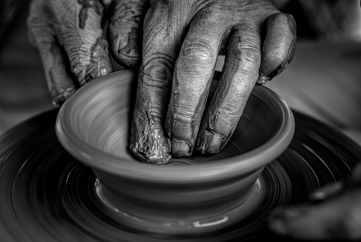 Hands on the pottery wheel