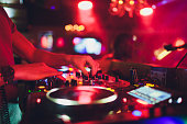 istock DJ hands on the remote. nightclub. DJ controlling and moving the mixers in music remote. 1136917636