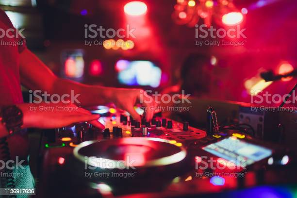 Hands on the remote nightclub dj controlling and moving the mixers in picture id1136917636?b=1&k=6&m=1136917636&s=612x612&h=lhasbyirhy3rlfodlwfipks277ktsctqkqbrpoopqy8=