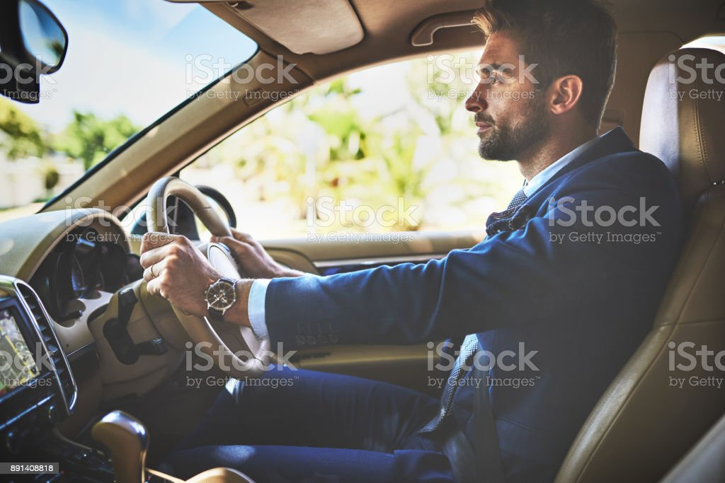 Hands on the wheel and eyes on the road stock photo