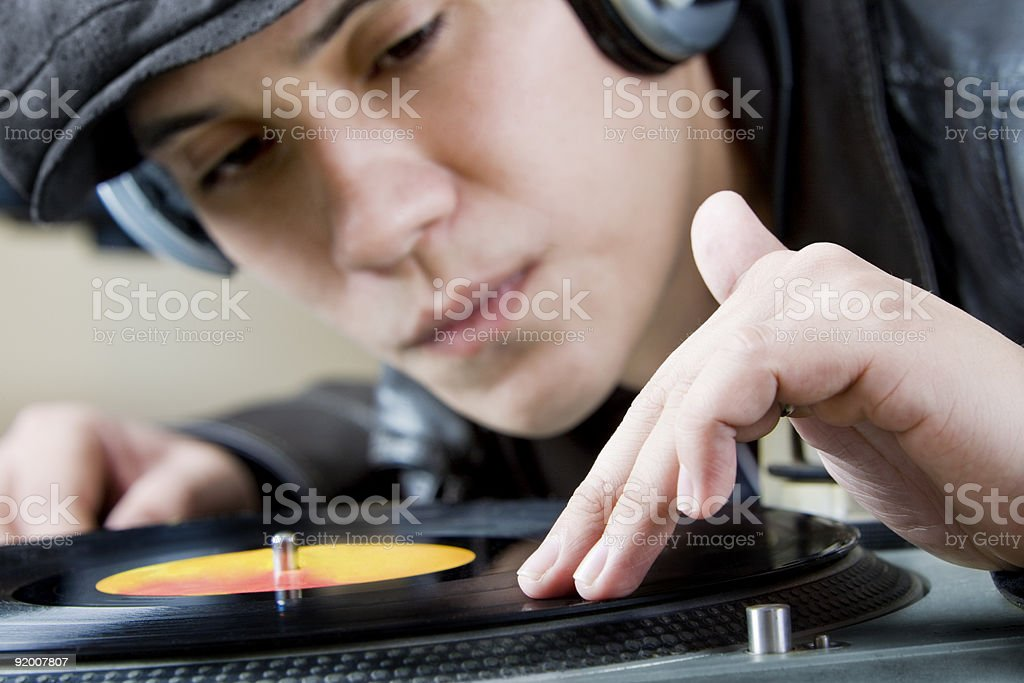 Hands on vinyl royalty-free stock photo