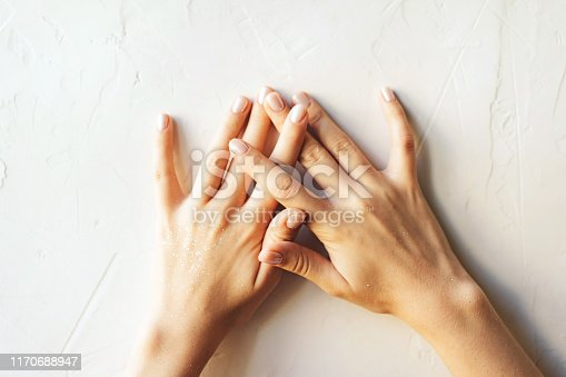 946930880istockphoto hands on white background fingers intertwined 1170688947