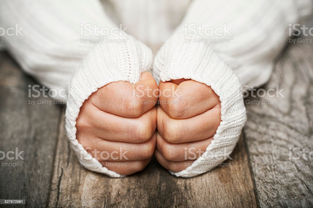 hands on   wooden table stock photo