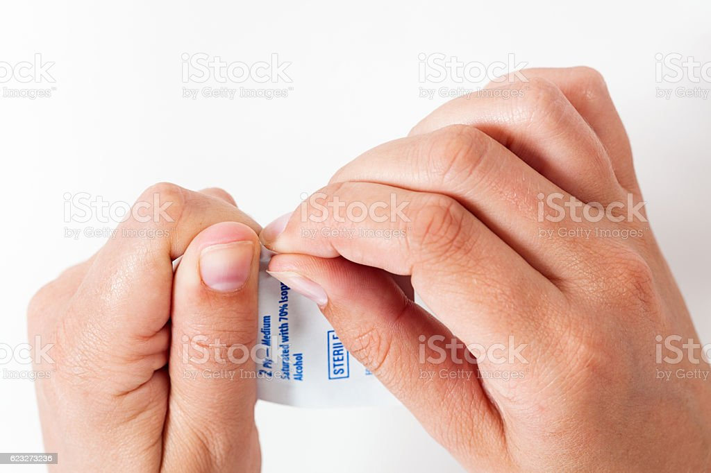 Hands open sterile swab for disinfecting skin or cleansing wounds stock photo