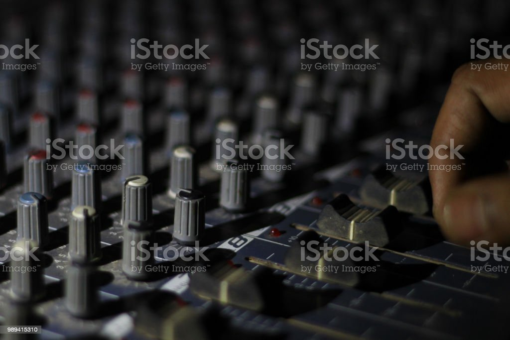 Hands Operating Buttons Of Light And Sound Board Console At