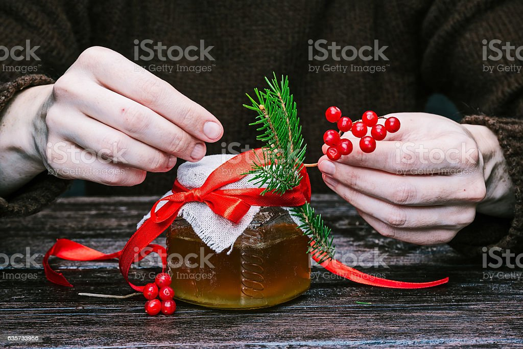 Hands packing honey stock photo