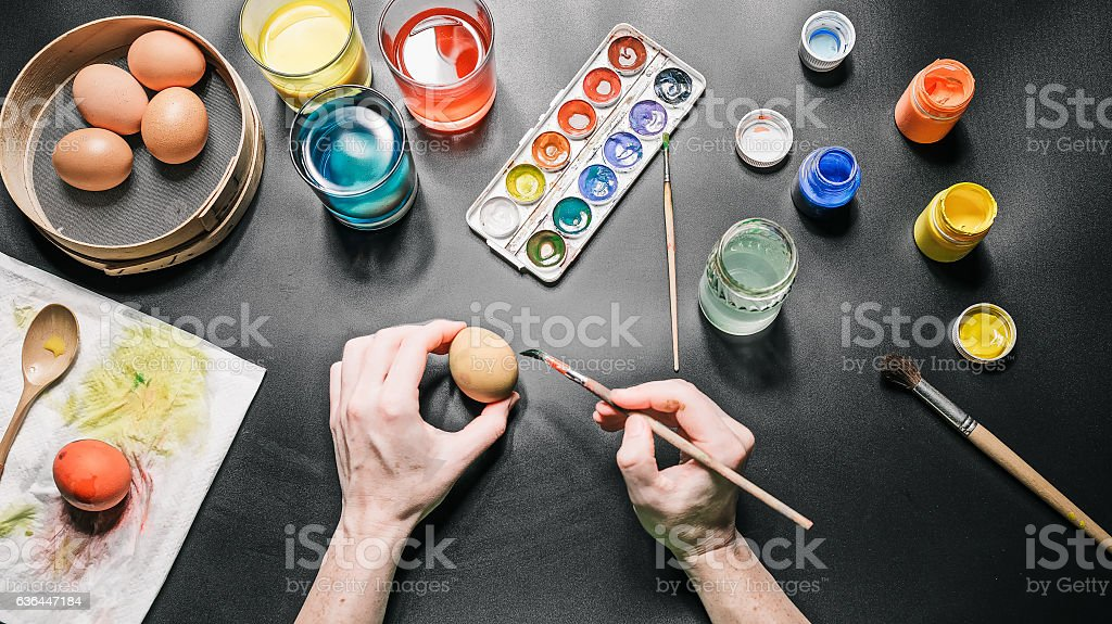Hands painting easter eggs stock photo