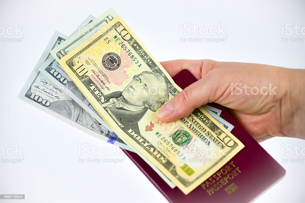 Hands, passport and currency royalty-free stock photo