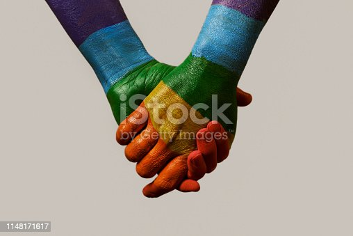 istock hands patterned with the rainbow flag 1148171617