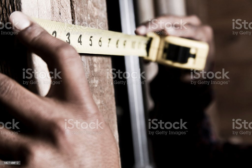 Hands performing measurements with measuring tape royalty-free stock photo