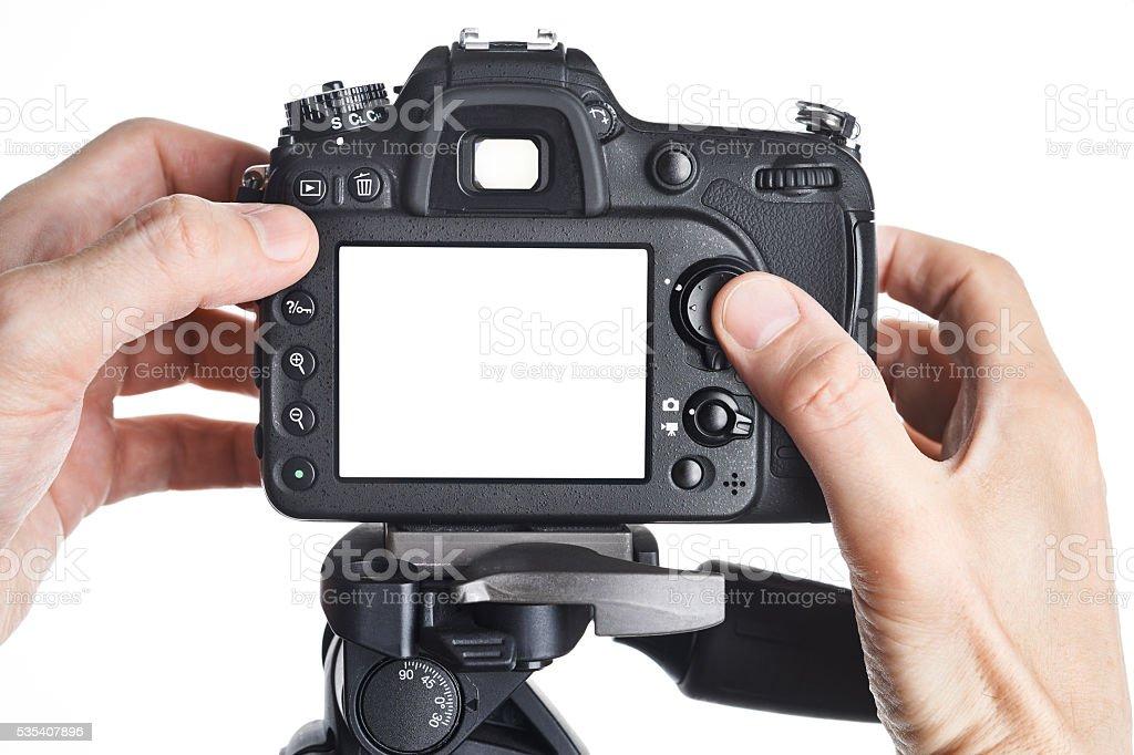 Hands photographer adjust SLR camera isolated stock photo