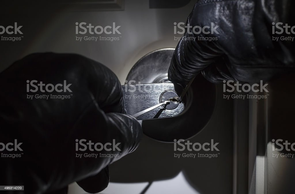 Hands Picking Lock stock photo