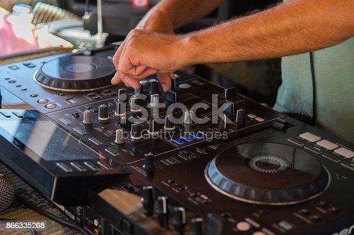 istock DJ, hands 866335268