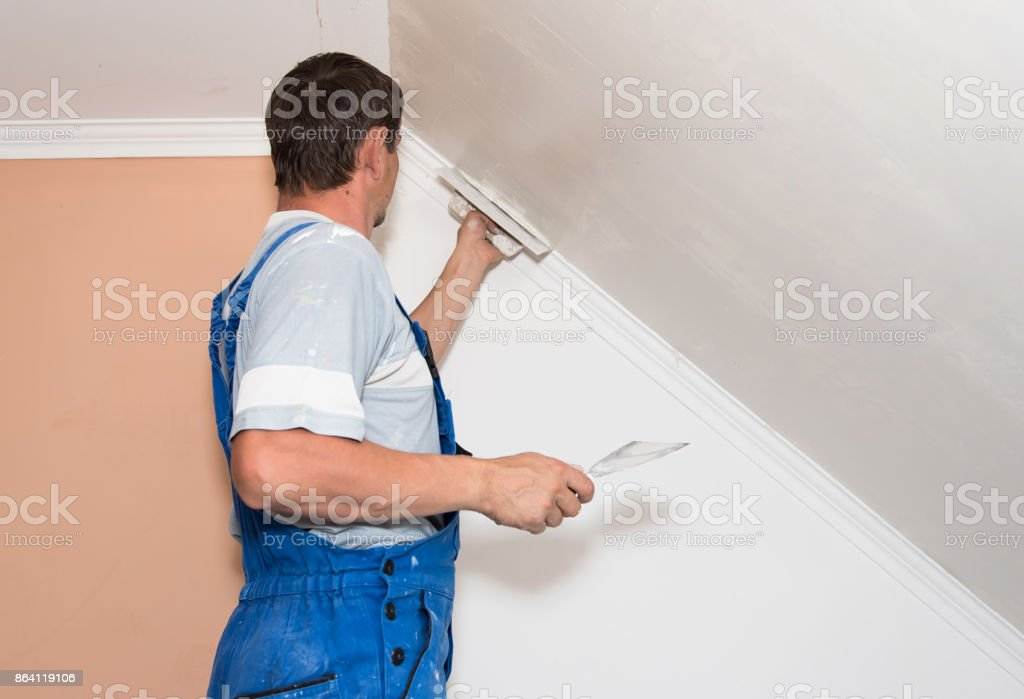 Hands plasterer at work royalty-free stock photo