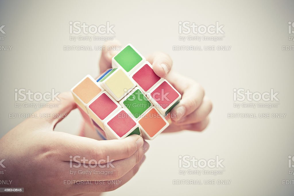 Hands playing a cube game royalty-free stock photo