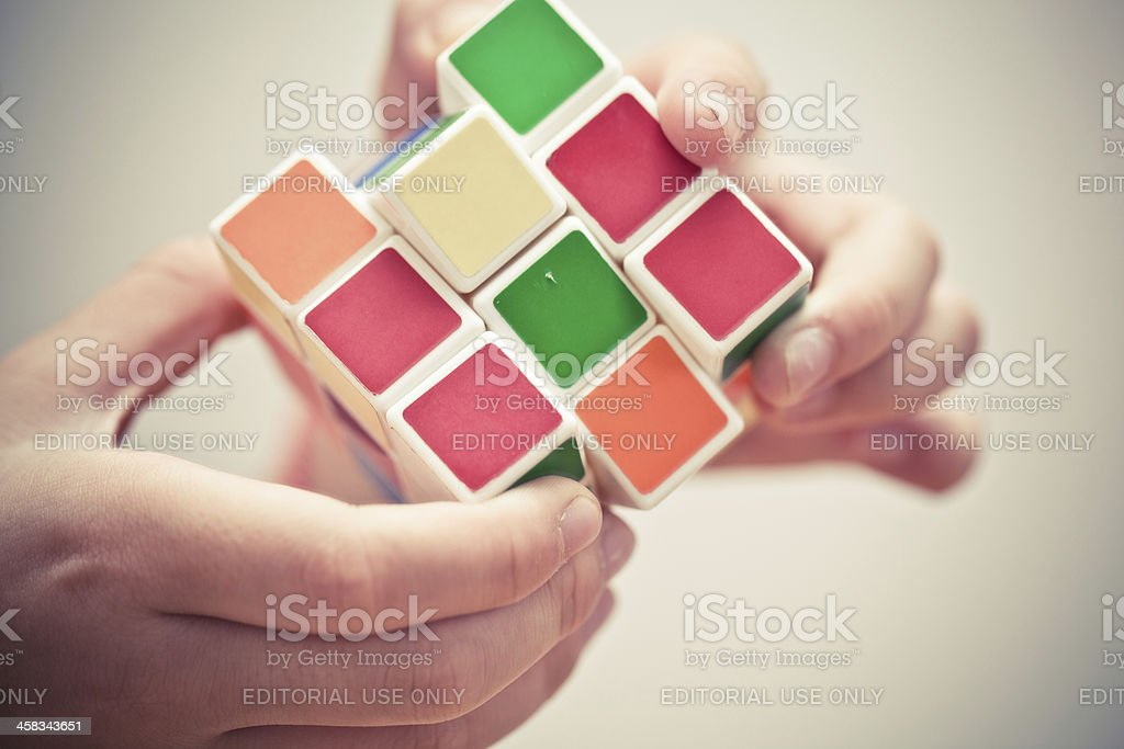 Hands playing a cube game stock photo