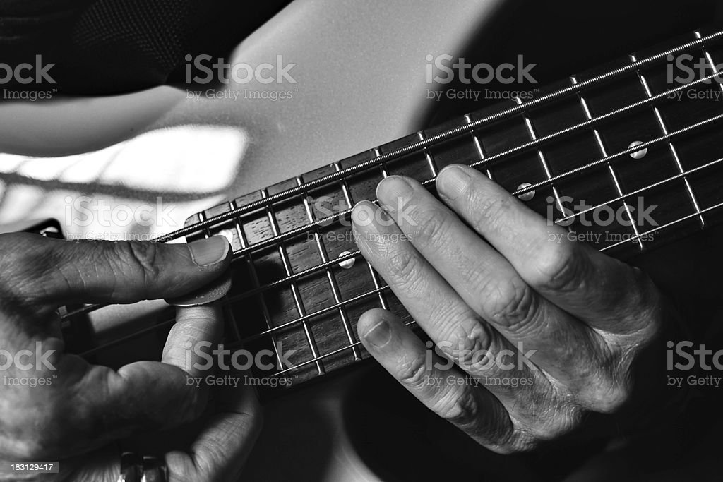 Hands playing a guitar royalty-free stock photo
