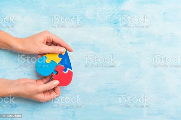 Hands playing a puzzle symbol of public awareness for autism spectrum picture id1214532938?b=1&k=6&m=1214532938&s=612x612&h=ubgfuvr 5wmmphqdifc24 jspyt xe01rgzdspfcgk4=