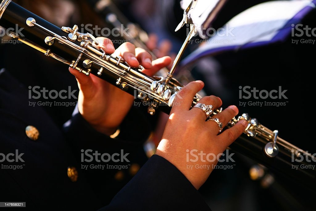 Hands playing clarinet royalty-free stock photo