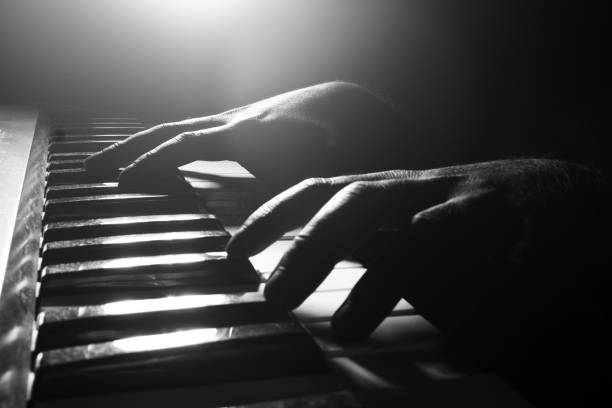 Hands playing piano close-up Hands playing piano close-up pianist stock pictures, royalty-free photos & images
