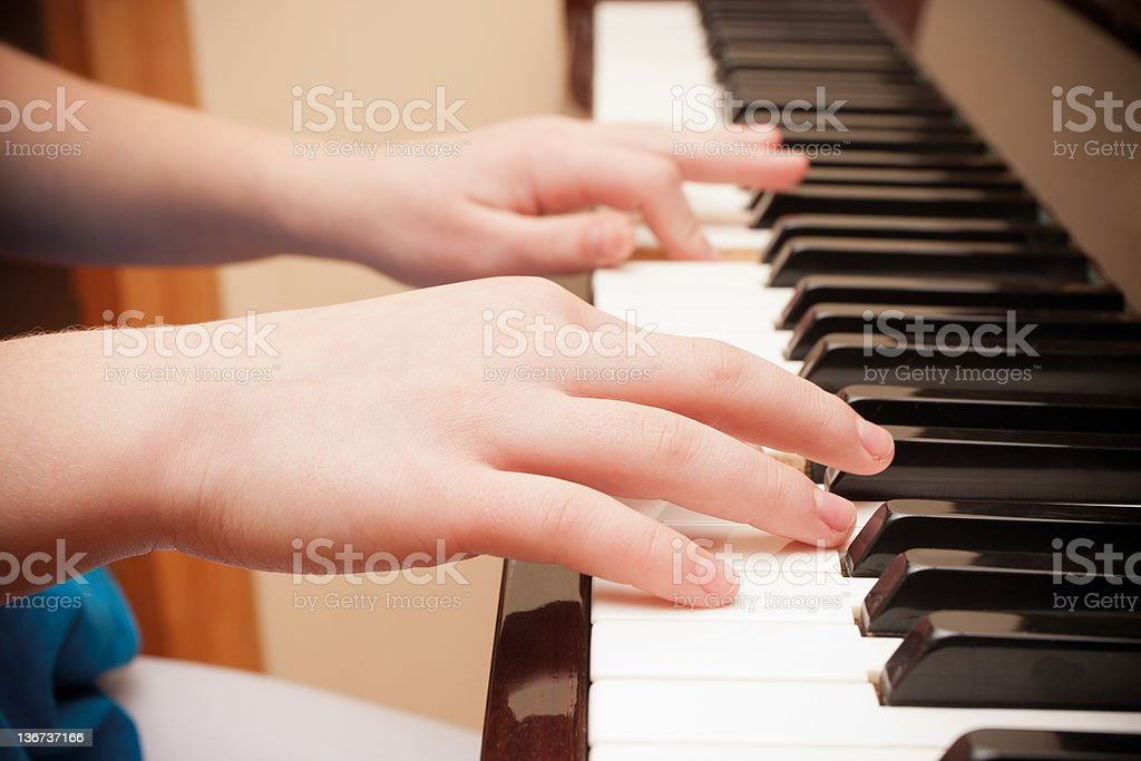 Hands playing piano royalty-free stock photo