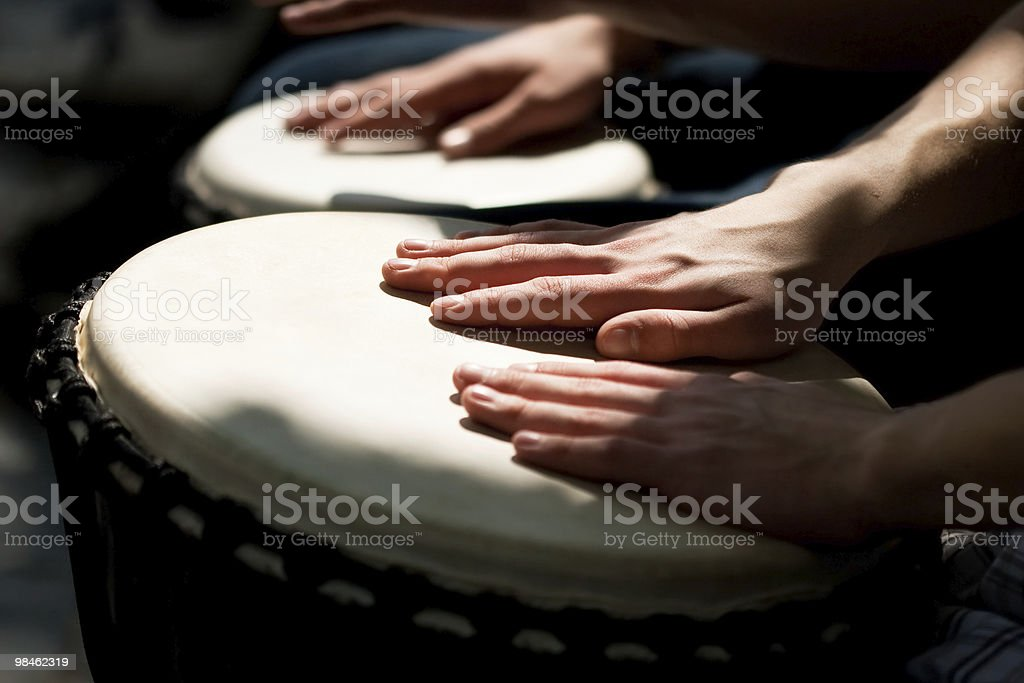 Hands playing the drums on the street stock photo